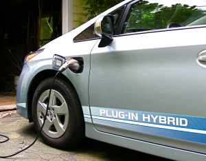 Plug-in Prius bumper sticker: My Car Is Probably Destroying The Planet More Slowly Than Your Car.