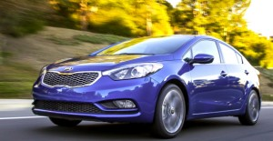 How do you like the sleek new nose? The longer, lower, wider 2014 Kia Forte EX Sedan is cheap to own and run, but comes with a lot of extras. Kia photo