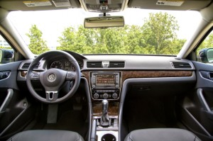 The photo doesn't do justice to the high-quality interior of the 2014 Passat SEL, but it does show us how many buttons, knobs and switches are available to play with. VW