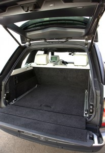 One of the improvements in this fourth-generation Range Rover is extra space in the back. (And note the tie-down rails on each side of the bay.) Both parts of the 70/30 split tailgate operate electrically. They open independently, but push the top button and both sections close, the bottom one first. Land Rover