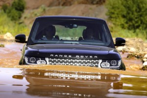 Did your driveway flood this spring? Range Rover engines breathe through four shielded intake vents cleverly tucked up inside the outer edges of the bonnet—er, hood—and so can wade through even more water than this. The camera lens in the front bumper provides a nifty underwater view. Look! A fish! Land Rover