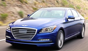 """Whether it's the V-6 or the V-8, the 2015 Hyundai Genesis sedan makes a big, bold statement. Note the LED lights, the safety-system sensors in the grille and at the top of the windshield, and the """"Bentley homage"""" badge. Hyundai"""