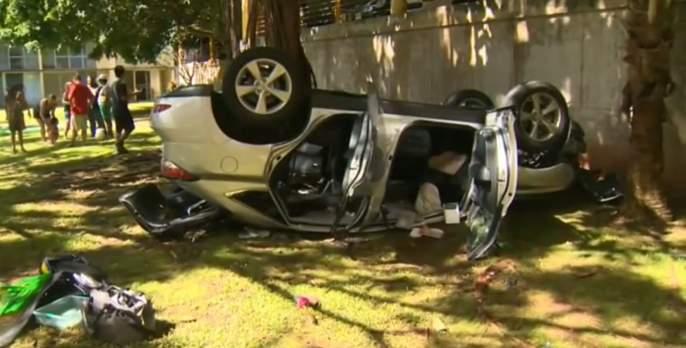 Woman drives lexus off parking garage roof - walks away