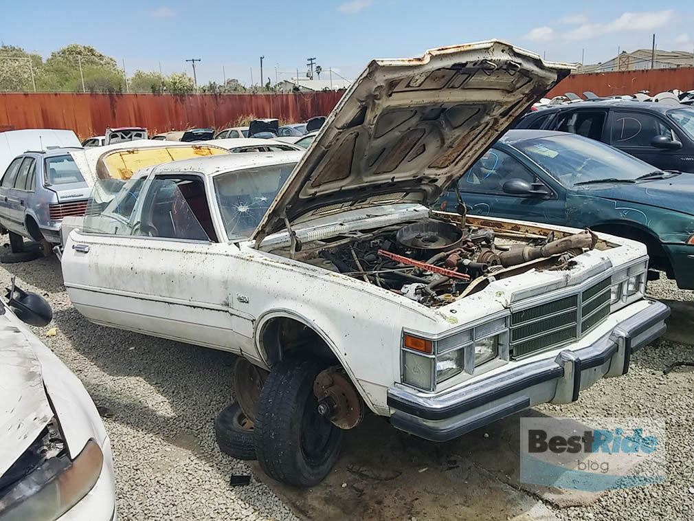 chrysler_lebaron_coupe_junkyard_1-1
