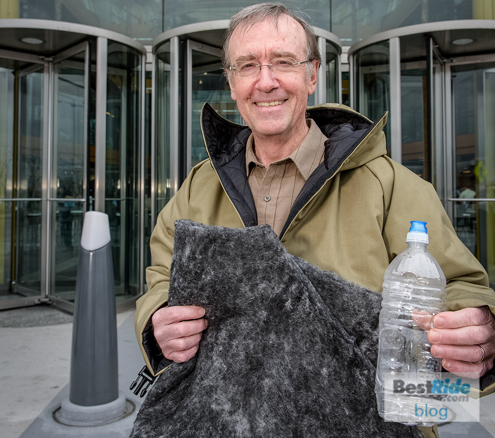 John Bradburn, GM's global manager of waste reduction, wears an Empowerment Plan coat insulated with a fleece material made from some of GM's used water bottles. (Photo by Santa Fabio for General Motors)