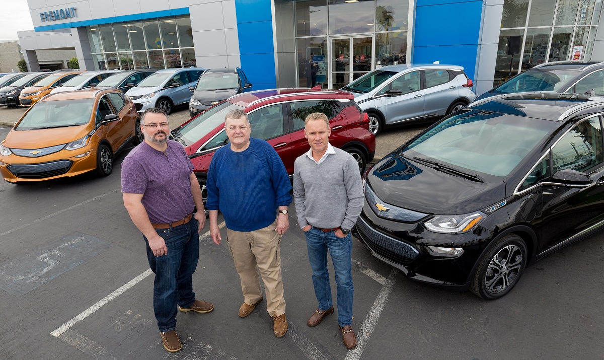 "Customers Bobby Edmonds (l to r) of Castro Valley, CA, William ""Bill"" Mattos of Fremont, CA, and Steve Henry of Portola Valley, CA take delivery of the first three 2017 Chevrolet Bolt EVs Tuesday, December 13, 2016 at Fremont Chevrolet in Fremont, CA. The all-electric Bolt EV offers an EPA-estimated 238 miles of range on a full charge. (Photo by Martin Klimek for Chevrolet)"